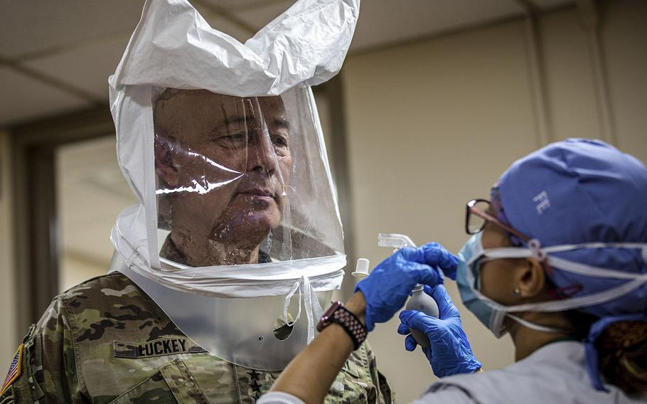 Lt. Gen. Charles D. Luckey, commanding general of the U.S. Army Reserve Command, gets fitted for a proper mask before a tour at University Hospital in Newark, N.J., April 21, 2020.