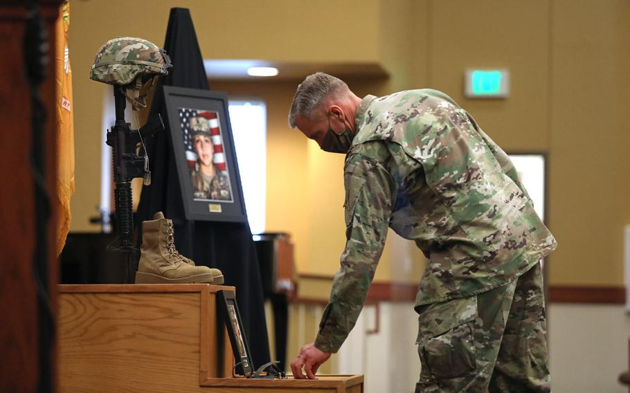 Maj. Gen. Scott Efflandt, III Corps and Fort Hood deputy commanding general, leaves a coin at the base of a Soldier's Cross for fallen Soldier Spc. Vanessa Guillen at the conclusion of a unit memorial service in the Spirit of Fort Hood Chapel, Fort Hood, Texas, July 17.