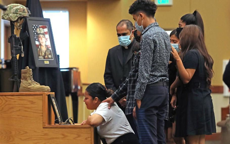 The family of Spc. Vanessa Guillen grieves in front of her Soldier's Cross during her unit memorial ceremony at Fort Hood, Texas, July 17.