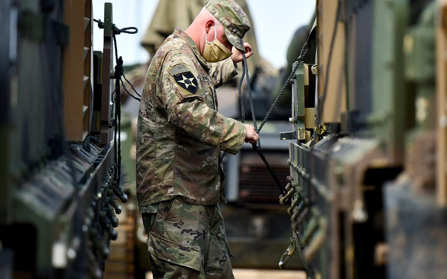 A soldier assigned to Bravo Company, 2nd Battalion, 12th Cavalry Regiment, conducts vehicle preparation procedures during Phase II of DEFENDER-Europe 20, Drawsko Pomorskie Training Area, Poland, July 20, 2020. In response to COVID-19, DEFENDER-Europe 20 was modified in size and scope.