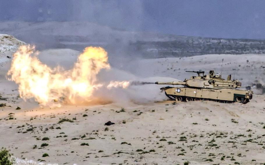 In a January, 2018 photo, an M1 Abrams tank from 2nd Brigade Combat Team, 1st Armored Division, Fort Bliss, Texas fires a 120mm round during a live fire exercise at Iron Union 18-6 in the United Arab Emirates.