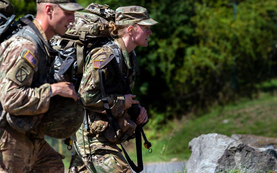 Army Sgt. Jake Weingarts, left, and Lt. Laura Benz walk to the next location during the 21st Theater Sustainment Command Best Medic Competition in Baumholder, Germany, Aug. 21, 2019. The competition tests medical and warfighter skills.
