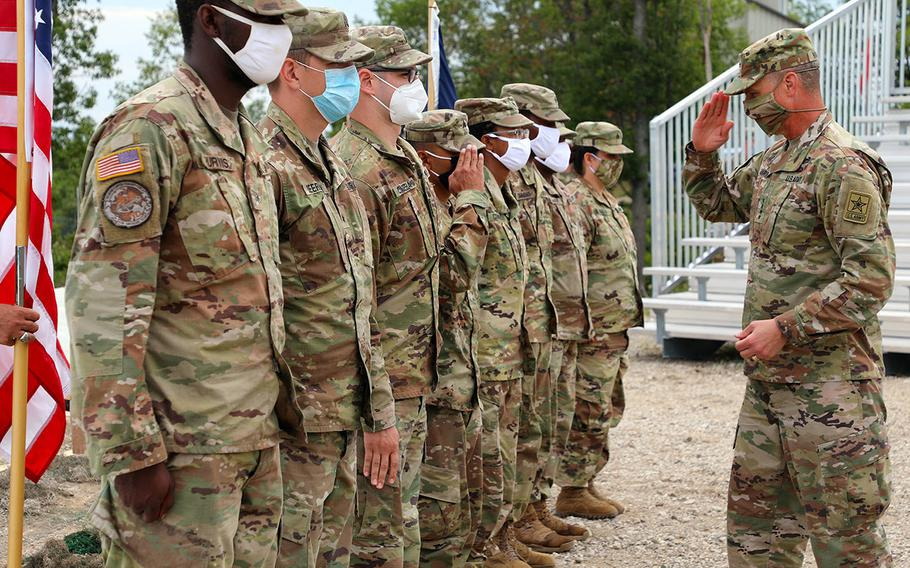 In a July 27, 2020 photo, Gen. Joseph M. Martin, Vice Chief of Staff of the U.S. Army, leads a reenlistment ceremony of Michigan National Guardsmen during the Northern Strike 2020 exercise at the Grayling Maneuver Training Center, in Grayling, Mich.
