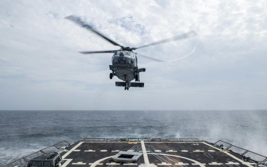 """An MH-60R Sea Hawk helicopter assigned to the """"Grandmasters"""" of Helicopter Maritime Strike Squadron 46 takes off from Arleigh Burke-class guided-missile destroyer USS Thomas Hudner's flight deck Aug. 2, 2020. Hudner is operating in the Atlantic Ocean in support of naval operations to maintain maritime stability and security in order to ensure access, deter aggression and defend U.S., allied and partner interests."""