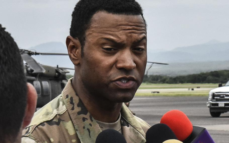 U.S. Army Col. Kevin Russell is interviewed by Honduran reporters after a change of command ceremony in July, 2018 at Soto Cano Air Base, where he assumed command of Joint Task Force-Bravo.