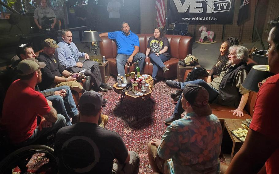 """Army veteran Vanessa Brown, center, is pictured in early 2020 with other cast members and the crew of """"Veterans Laughing Together,"""" a documentary series launched in July on the video-on-demand channel VET-Tv. Brown, the only female combat-wounded veteran on the show, was 'the hardest' of them all, said retired Army Special Forces member Nathan Smith to her left, wearing a tie."""