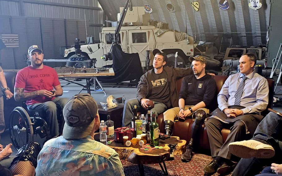 """Pictured on the set in early 2020 at March Air Force Base in Riverside, Calif., of video-on-demand channel VET-Tv's new documentary series """"Veterans Laughing Together"""" are, left to right, Marine veteran Paul Gardner, Marine veteran and VET-Tv founder Donny O'Malley, Army veteran Joseph James and Army Special Forces veteran Nathan Smith."""