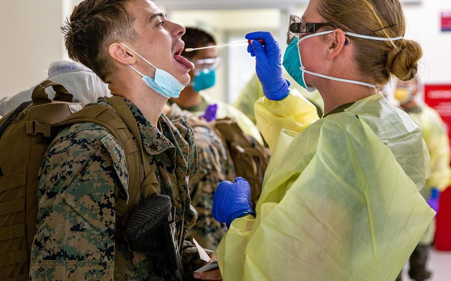 U.S. Marines with Marine Rotational Force-Darwin arrive at the Royal Australian Air Force Base Darwin, NT, Australia, July 24, 2020. The Marines underwent biosecurity testing, as well as testing for COVID-19, before being transported to their quarantine quarters.