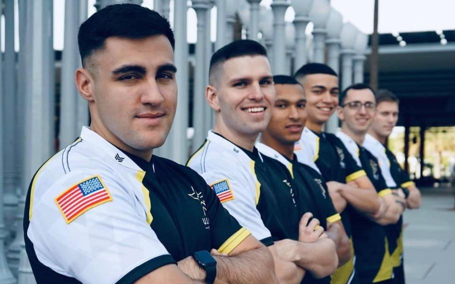 Staff Sgt. Nicholas Mackay (left) poses in a promotional photo for the newly formed Army Esports team. Mackay was one of 6,500 applicants for the competitive video gaming team, becoming one of just 16 ultimately selected.