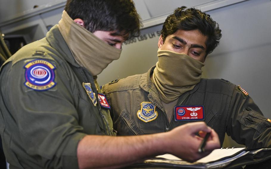 9th Air Refueling Squadron KC-10 Extender pilots review a pre-flight checklist June 17, 2020, at Travis Air Force Base, Calif.