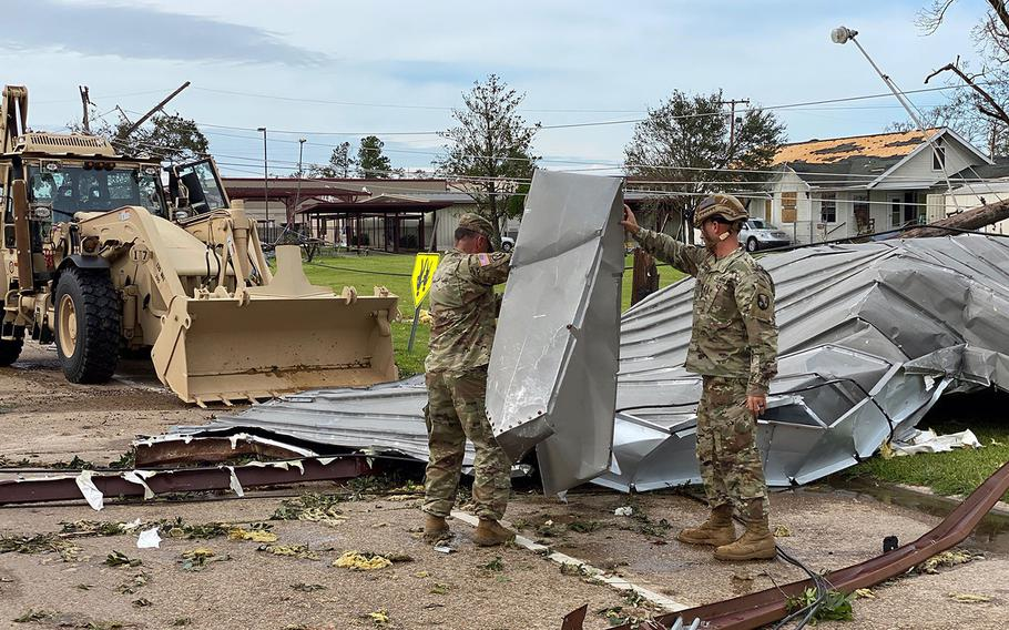 Louisiana National Guard members deploy to clear roads in Lake Charles and begin to assess the damage from Hurricane Laura on Thursday, Aug. 27, 2020.