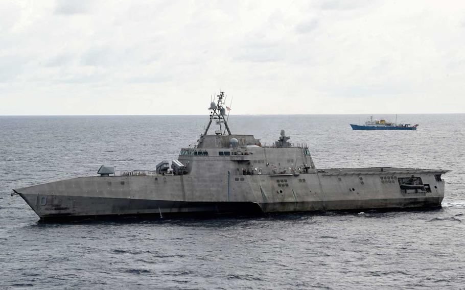 The Independence-variant littoral combat ship USS Gabrielle Giffords (LCS 10), left, conducts routine operations in the vicinity of the Chinese vessel Hai Yang Di Zhi 4 Hao, July 1, 2020.