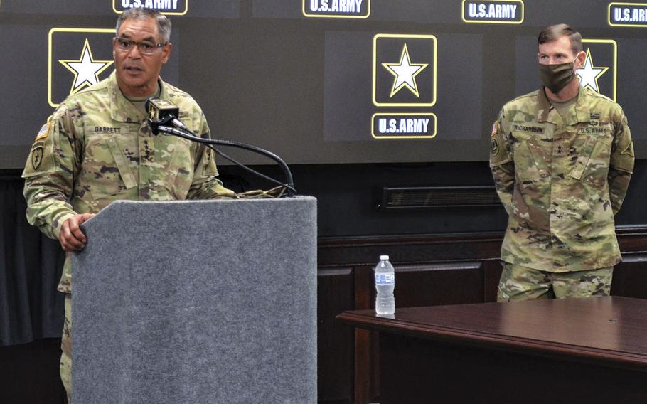 Gen. Michael Garrett, commander of Army Forces Command, addresses concerns about trust in leadership at Fort Hood as the new acting base commander Maj. Gen. John Richardson looks on during a news conference Wednesday at Fort Hood, Texas.