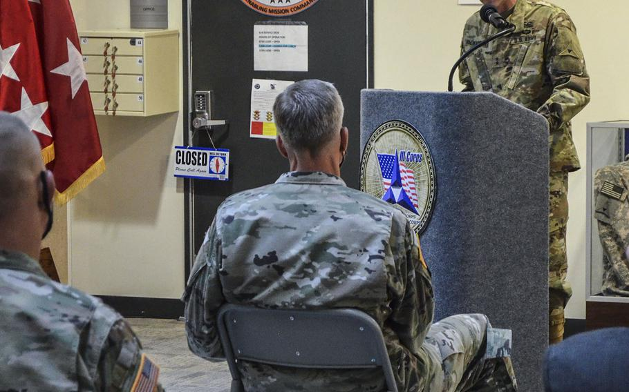 Maj. Gen. John Richardson formally stepped into the role of acting Fort Hood commander and deputy commander of III Corps as his predecessor Maj. Gen. Scott Efflandt sits in the front row during a ceremony Wednesday to mark the occasion. Efflandt will remain at the Texas base while a series of investigations look into his handling of the disappearance and death of Spc. Vanessa Guillen.