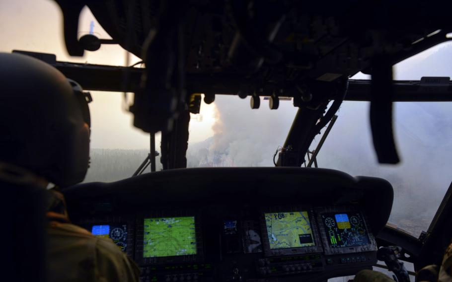 Oregon Army National Guard Black Hawk Pilot in command CWO4 Joe Zeiner, from G/1-189 Aviation (MEDEVAC) out of Salem, Ore., approaches a giant smoke plume in flight for aerial water drop operations in eastern, Oregon, Aug. 22, 2020.