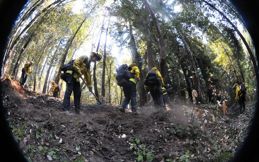 Bravo team from the California Army National Guard's Task Force Rattlesnake out of Redding, Calif., create a defensive fire line Sept. 1, 2020, at Bonny Doon, Santa Cruz County, during the CZU Lightning Complex Fire in Santa Cruz and San Mateo counties.