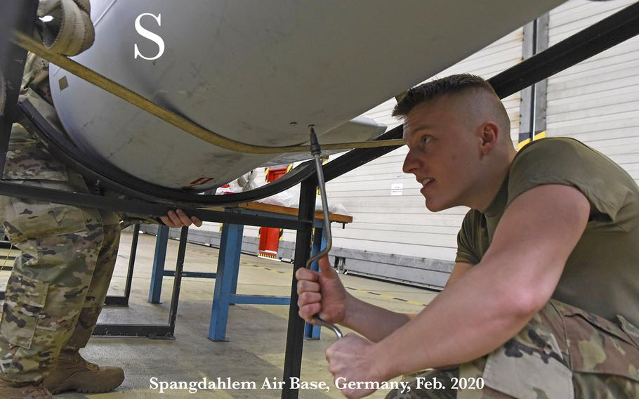 U.S. Air Force Senior Airman Tanner Sterner, 52nd Maintenance Squadron aerospace propulsion journeyman, assists with taking apart a fuel tank during a nestable fuel-tank build up familiarization event at Spangdahlem Air Base, Germany, Feb. 24, 2020. The event allowed augmentees to work outside of their career field and learn a new side of the 52nd FW mission.