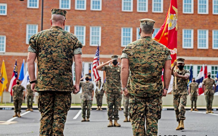 U.S. Marines with Marine Corps Intelligence Activity, Marine Corps Base Quantico, participate in a change of command ceremony, June 19, 2020 aboard MCB Quantico, Virginia. Change of command ceremonies are an established tradition within the Marine Corps that mark the beginning and ending of a successful tour of leadership.