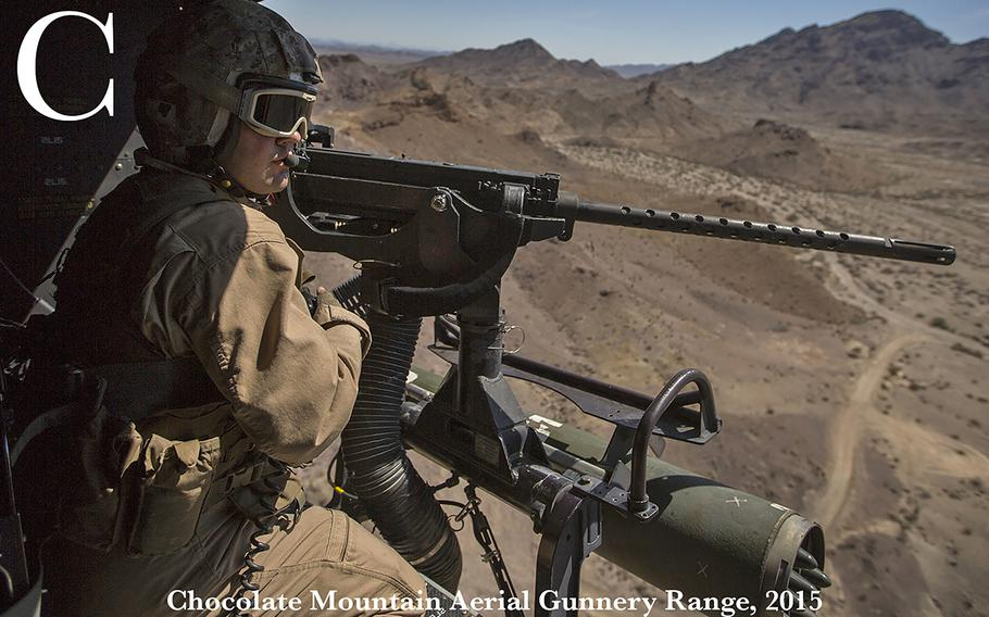 U.S. Marine Corps Sgt. Robert Brown, with Marine Light Attack Helicopter Squadron 469 (HMLA-469), looks out the UH-1Y Venom during an aerial gunnery refinement exercise at Mt. Barrow, Chocolate Mountain Aerial Gunnery Range, Calif., Sept. 30, 2015. This exercise was part of the Weapons and Tactics Instructor (WTI) Course 1-16, a seven week training event, hosted by Marine Aviation Weapons and Tactics Squadron One (MAWTS-1) cadre, which emphasizes operational integration of the six functions of Marine Corps aviation in support of a Marine Corps Air Ground Task Force. MAWTS-1 provides standardized advanced tactical training and certification of unit instructor qualifications to support Marine Aviation Training and Readiness and assists in developing and employing aviation and tactics.