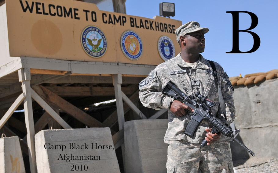 Spc. Robert Whitehead, of Purvis, Miss., a security guard for Headquarters Support Company of the 101st Airborne Division (Air Assault), stands guard near the entrance to Camp Black Horse, Oct. 10. Whitehead and other soldiers from the 101st provide security and sustainment support services for more than 700 U.S. and coalition forces who reside on the camp.
