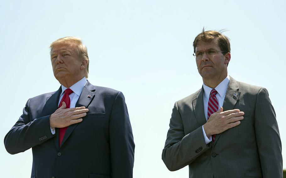 President Donald Trump and Secretary of Defense Mark Esper stand as the national anthem is played outside the Pentagon, July 25, 2019.
