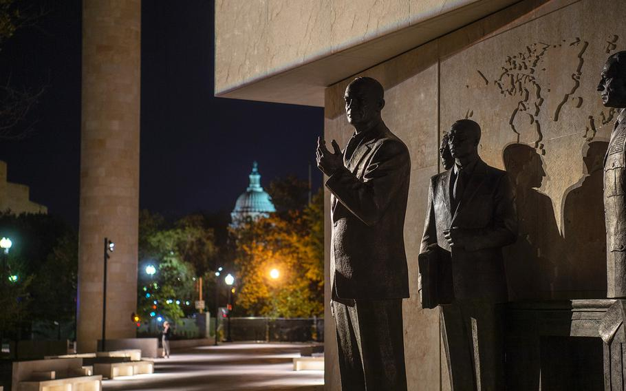 With the U.S. Capitol building seen in the distance, sculptures depicting the 34th president standing with military and civilian advisors are seen on a display at the new Dwight D. Eisenhower Memorial in Washington D.C., on Sept. 8, 2020.