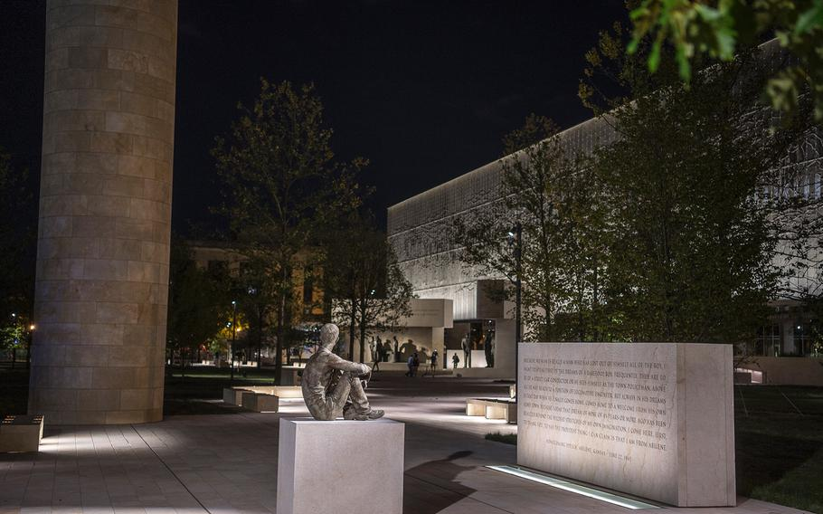 """A life-size sculpture of Ike Eisenhower as a young man sitting on a pedastal decorates the west end of the new Dwight D. Eisenhower Memorial in Washington D.C., on Sept. 8, 2020. To the right, an engraved block contains Eisenhower's June 22, 1945, homecoming speech in Kansas, where he declared """"the proudest thing I can claim is that I am from Abilene."""""""