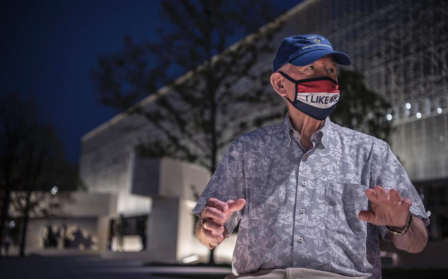 """Executive director of the Dwight D. Eisenhower Memorial Commission retired Air Force Brig. Gen. Carl Reddel speaks behind an """"I like Ike"""" face mask on the grounds of the new Dwight D. Eisenhower Memorial in Washington D.C., on Sept. 8, 2020."""