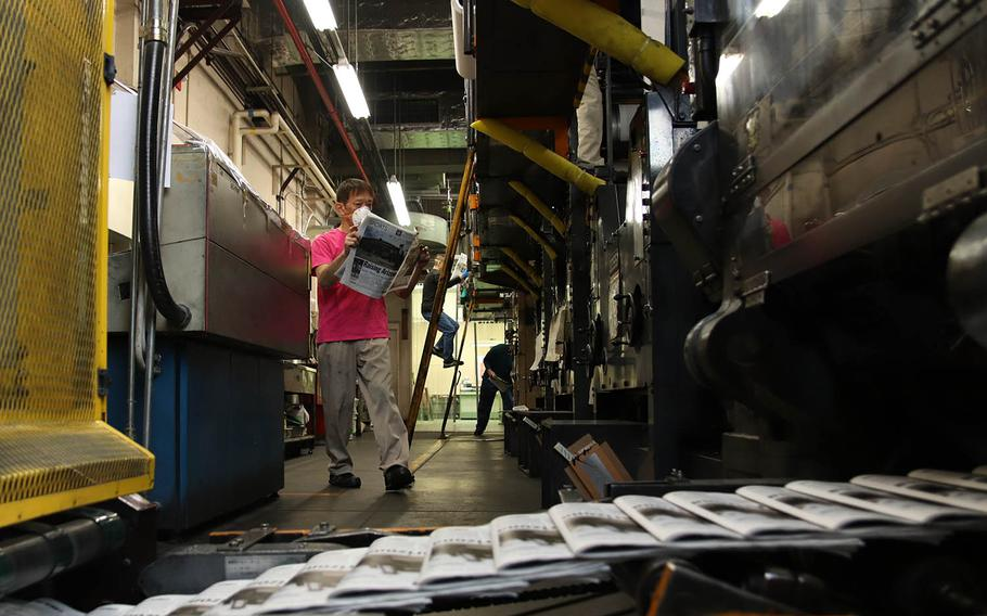 An issue of Stars and Stripes rolls off the press in central Tokyo, April 4, 2020.