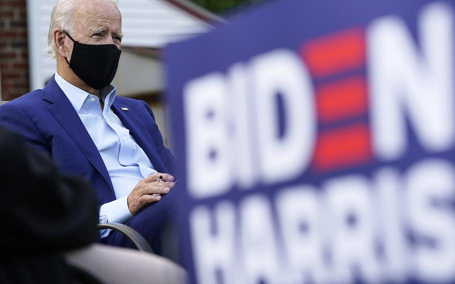 Democratic presidential candidate former Vice President Joe Biden listens during a campaign event with steelworkers in the backyard of a home in Detroit, Wednesday, Sept. 9, 2020.