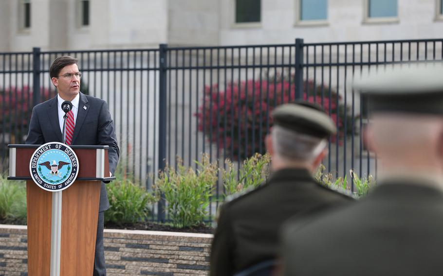 Defense Secretary Mark Esper speaks during the Pentagon's 9/11 observance ceremony in the National 9/11 Pentagon Memorial located across from the site of the attack on Friday, Sept. 11, 2020.