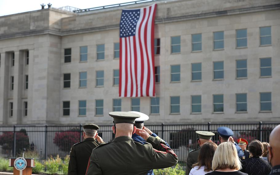 """Attendees of the Pentagon's 9/11 observance ceremony stand and salute during """"Taps"""" on Friday, Sept. 11, 2020."""