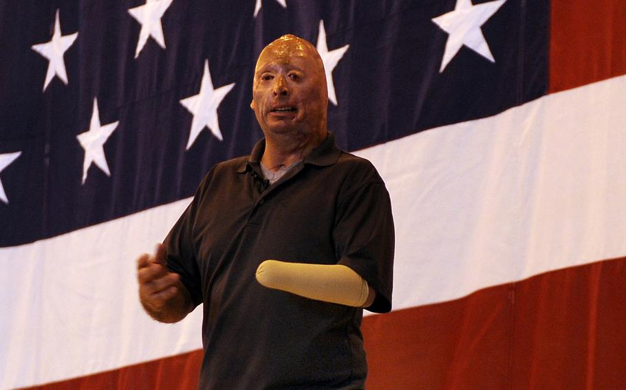 Army veteran Staff Sgt. Bobby Henline talks of his injuries and healing process before transitioning into his stand-up comedic act, while touring Offutt Air Force Base, Neb., on May 24, 2012. In a video post in September 2020, Henline is demanding people stop using his image for political propaganda purposes.