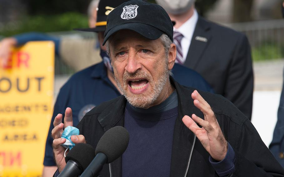 Comedian Jon Stewart speaks in front of the U.S. Capitol in Washington on Tuesday, Sept. 15, 2020, as advocates lobby for legislation that would provide benefits to military veterans who have been exposed to toxins from burn pits used at overseas locations.