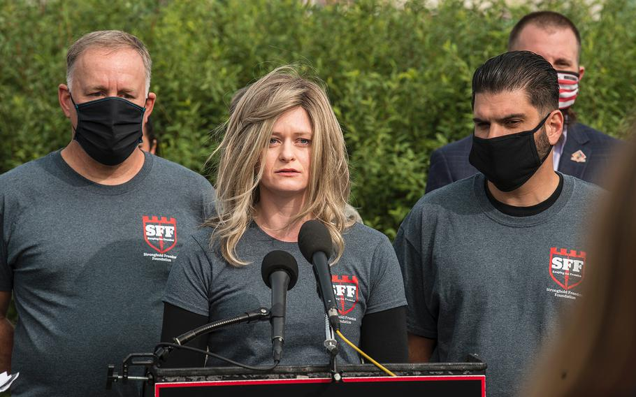 Danielle Robinson speaks in front of the U.S. Capitol in Washington on Tuesday, Sept. 15, 2020. Her late husband Sgt. 1st Class Heath Robinson was an Army medic who died in May after battling a rare cancer believed to be related to his burn pit exposure while he was deployed to Iraq.