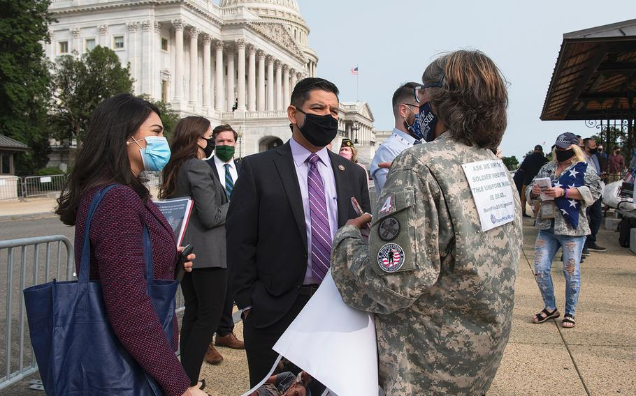 U.S. Rep. Raul Ruiz, D-Calif., speaks with Susan Freier in front of the U.S. Capitol in Washington on Tuesday, Sept. 15, 2020. Freier, whose  late son-in-law Sgt. 1st Class Heath Robinson died of cancer in May, joined other advocates to lobby for legislation that would provide benefits to military veterans who have been exposed to toxins from burn pits used at overseas locations.