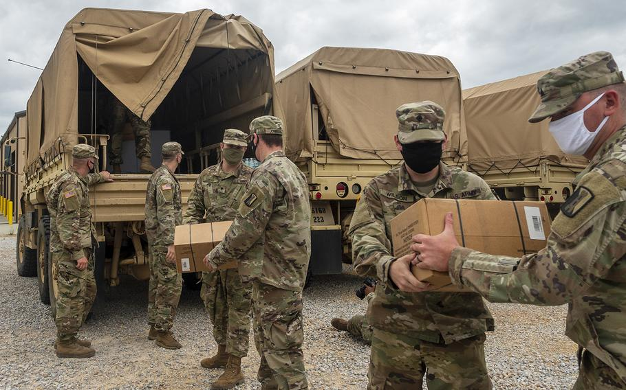 Soldiers with the Mississippi Army National Guard unload supplies at Camp Shelby Joint Forces Training Center near Hattiesburg, Miss., on Tuesday, Sept. 15, 2020, in preparation to respond to Hurricane Sally.