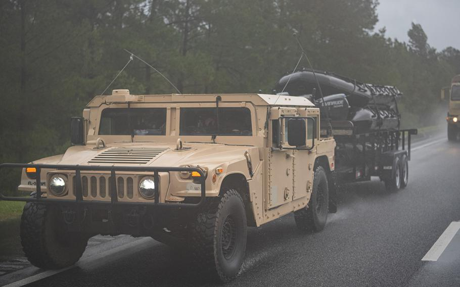 Military vehicles, some towing boats for high water search and rescue, move toward affected areas of Floriday as Hurricane Sally came ashore on Sept. 16, 2020.