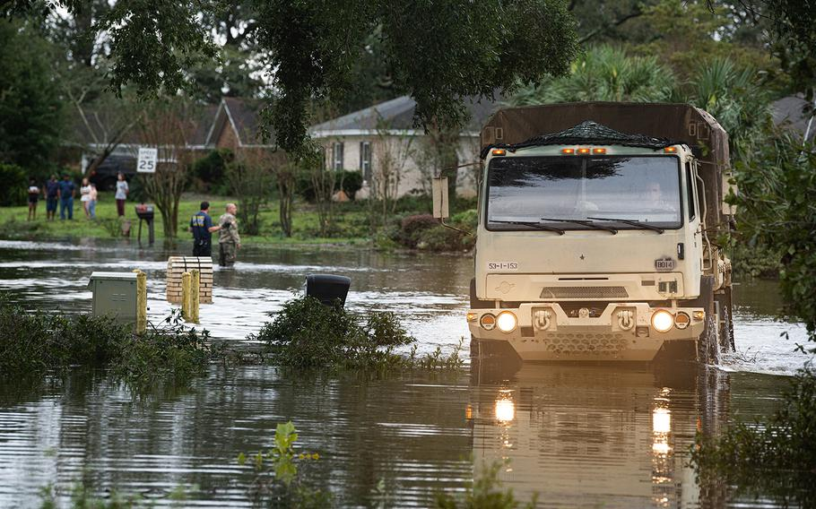 Troops from the Florida National Guard assist residents of Escambia County following Hurricane Sally on Wednesday, Sept. 16, 2020.