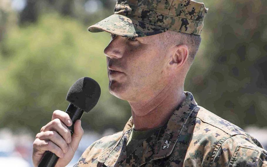 In a July 14, 2017 photo, U.S. Marine Corps Col. Stephen Keane, incoming commanding officer of Security and Emergency Services Battalion, speaks during a change of command ceremony aboard Camp Pendleton, Calif.