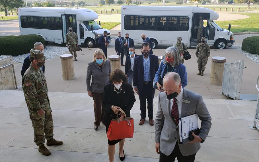 """An eight-member congressional delegation on Friday visited Fort Hood, Texas, as part of an inquiry into the Army base. Acting base commander, Maj. Gen. John Richardson, far left, pledged to provide the lawmakers detailed information to give a """"full understanding of the challenges Fort Hood is facing."""""""