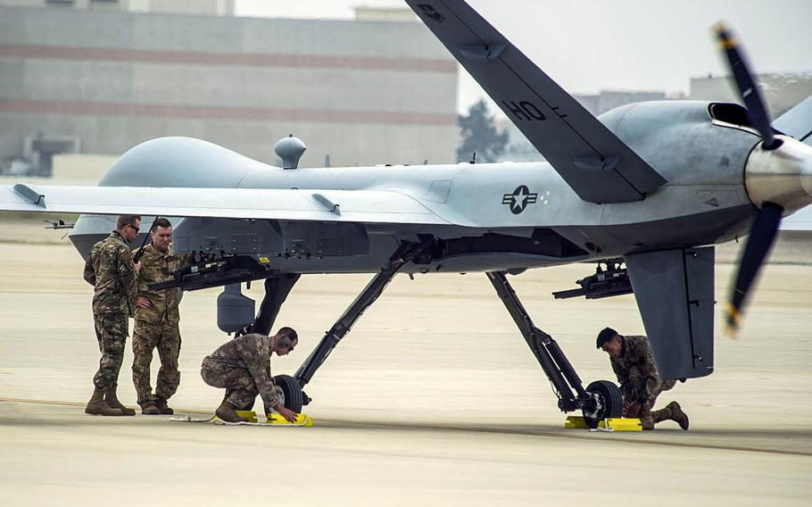 Maintainers from the 9th Aircraft Maintenance Unit and an operator from the 29th Attack Squadron work to recover a MQ-9 Reaper during Exercise Agile Reaper at Naval Air Station Point Mugu, Calif., Sept. 12, 2020.