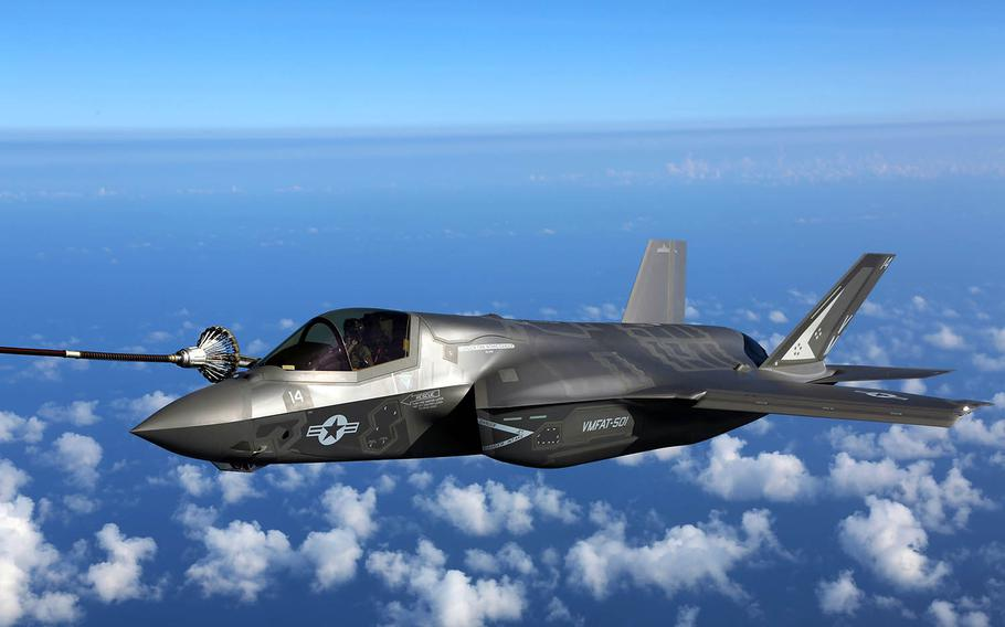An F-35B joint strike fighter jet attaches to the hose of a KC-130J during aerial refueling training over the Atlantic Ocean, Aug. 13, 2015.