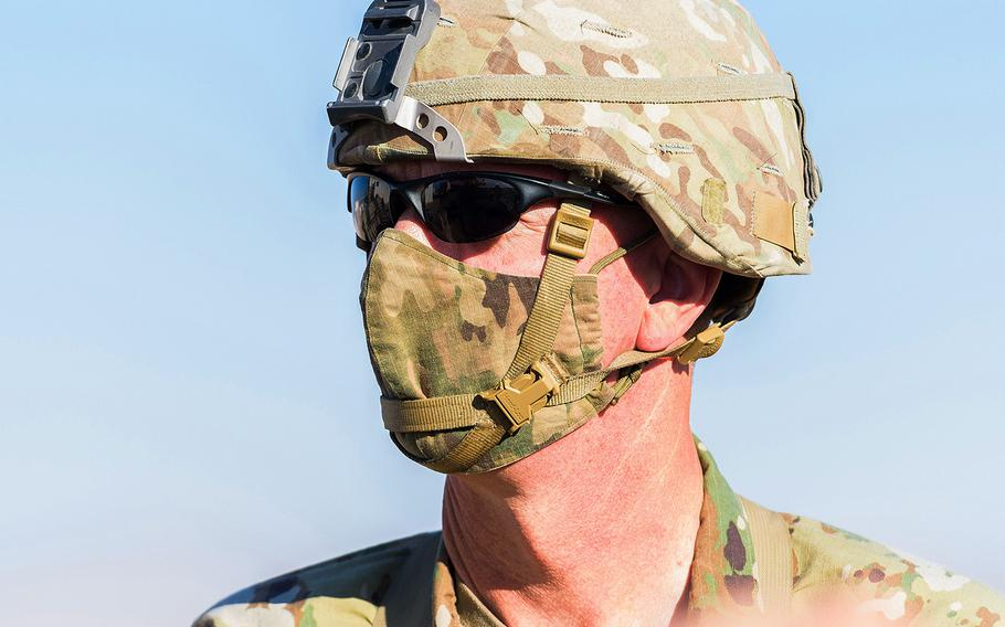 Brig. Gen. David Lesperance, the senior commander for the Army's National Training Center at Fort Irwin in California, wears a face mask as he inspects a 1st Infantry Division training rotation at the massive Mojave Desert training post on Sept. 20.