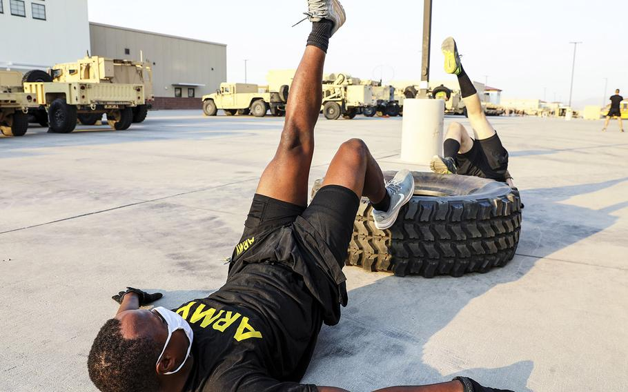 1st Armored Division soldiers from the 4th Battalion, 70th Armor Regiment, 1st Brigade Combat Team perform single-leg hipups during an early-morning Holistic Health and Fitness (H2F) physical training session on at Fort Bliss, Texas, Aug. 21, 2020.
