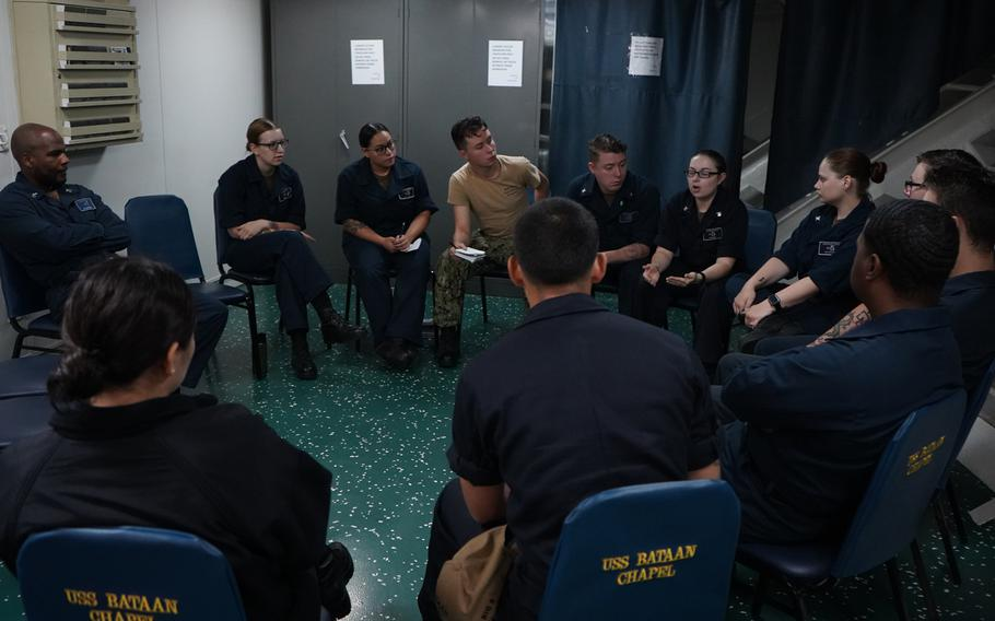 Members of the amphibious assault ship USS Bataan's Suicide Prevention Team conduct a team meeting in the ship's chapel on July 18, 2019.