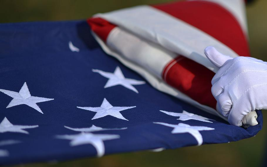 Funeral folded flag performed at a funeral for veterans with full military honors.