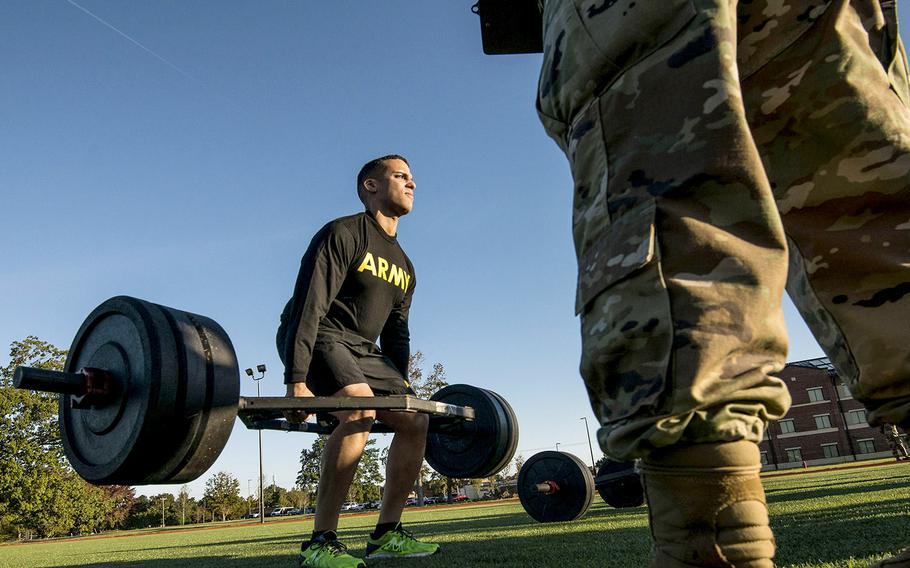In an October, 2018 photo, a soldier with the 128th Aviation Brigade at Fort Eustis, Va., attempts the deadlift during a demonstration of the Army's new Army Combat Fitness Test.