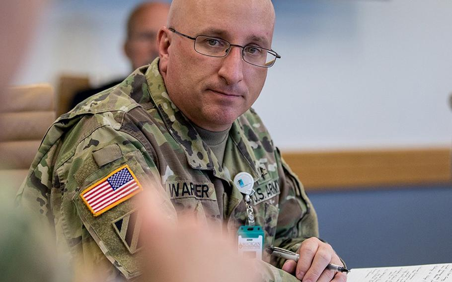 Col. Christopher Warner was suspended Oct. 2 from his duties as commander of Madigan Army Medical Center at Joint Base Lewis-McChord, Wash.