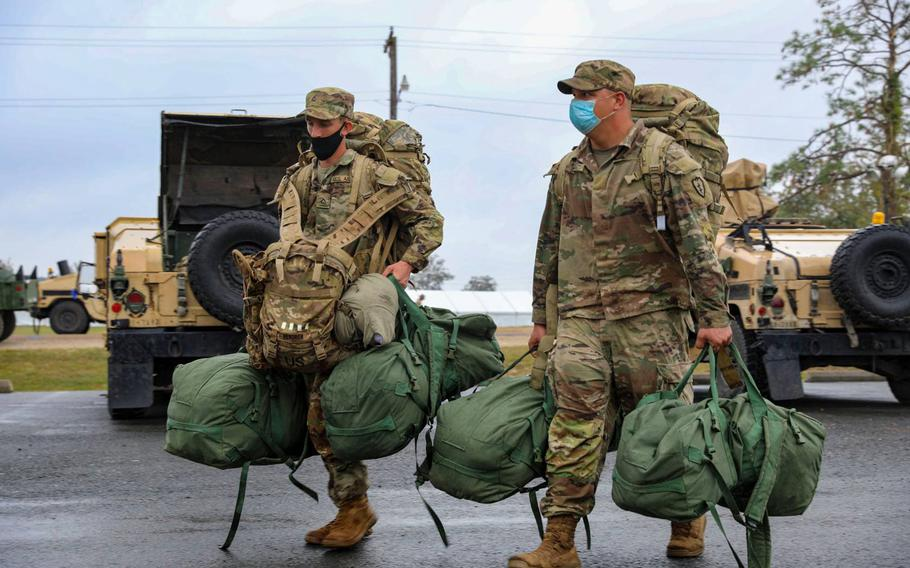 Soldiers with the 2nd Infantry Brigade Combat Team, 25th Infantry Division, move supplies from the tent city at the Joint Readiness Training Center at Fort Polk, La., Oct. 8, 2020, to more secure living quarters as Hurricane Delta approaches the state.